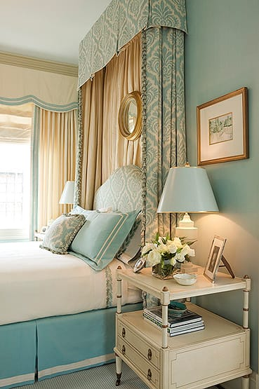 the cool blue tones and gold accents make this bedroom both elegant