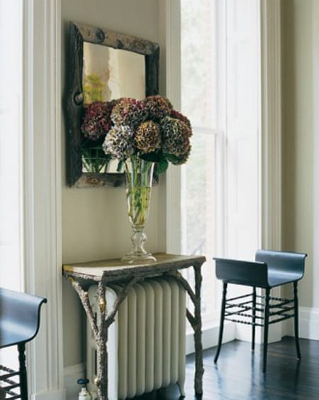 This Unique, Rustic Table Draws Your Eye From The Radiator Into A Beautiful  Vignette.