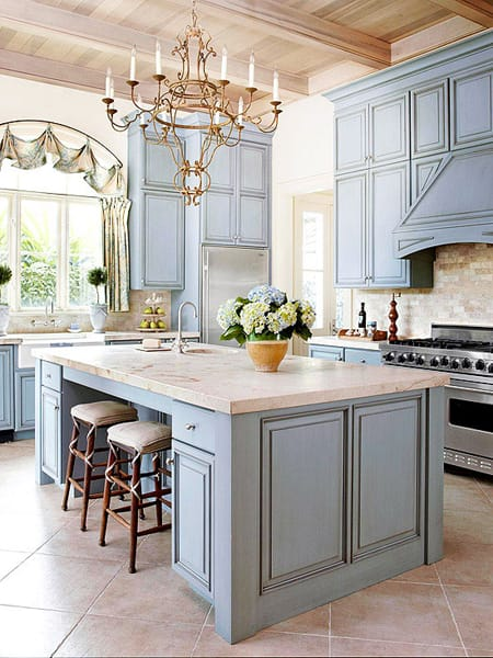 An antiqued stain gives these blue cabinets an upscale cottage appeal