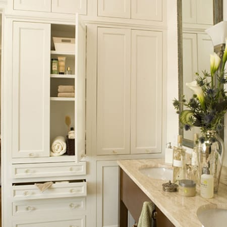 this built in linen closet in the bathroom not only uses the space to