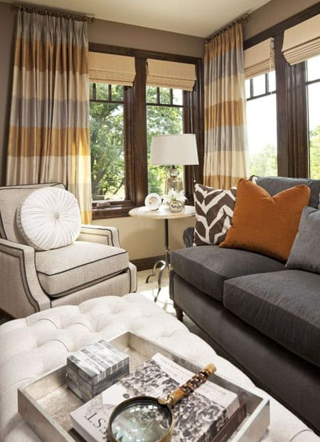 Subdued tones of grey brown cream and orange bring an earthy touch