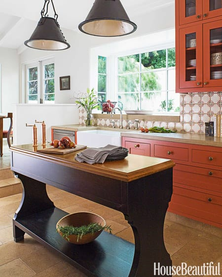 Burnt orange cabinets mix well with wood tones and bring a vintage