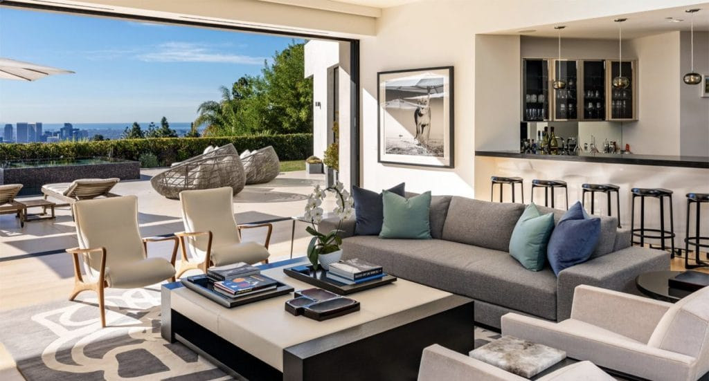 Living room with couch and chairs and a view to the backyard