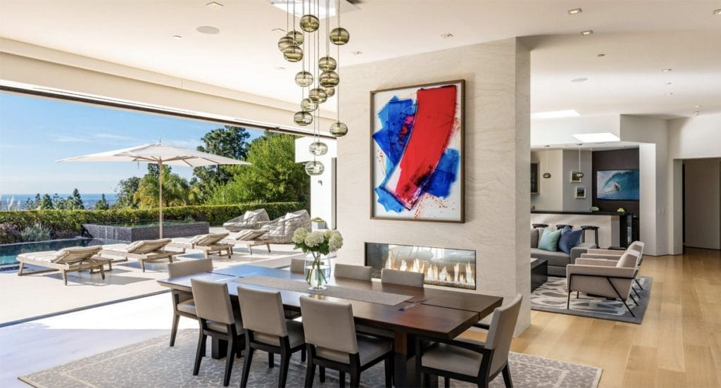 Dining room with a view past the pool to the city