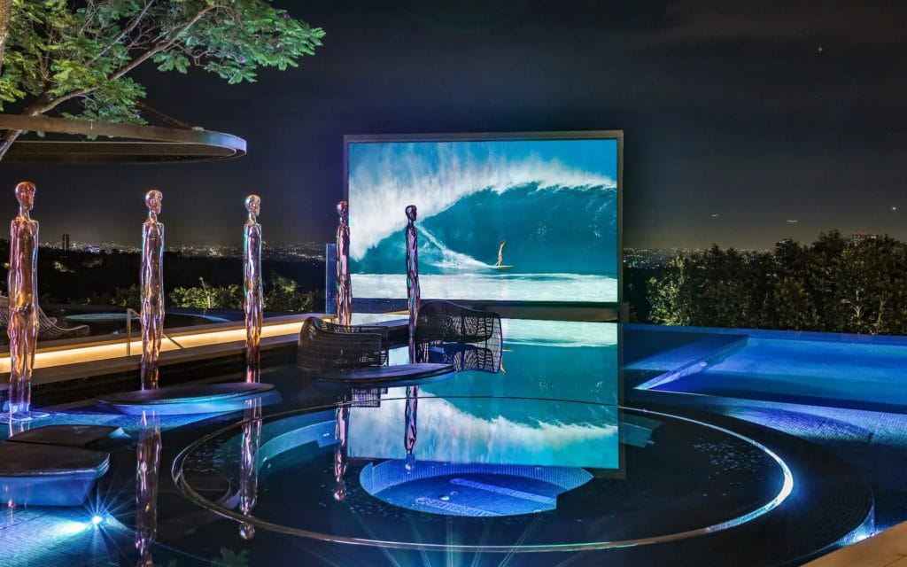 Projector screen on the pool deck at 822 Sarbonne