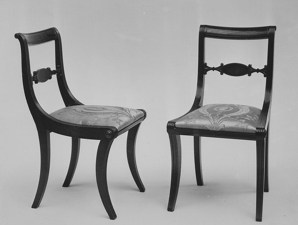 Two gray klismos chairs designed by Duncan Phyfe