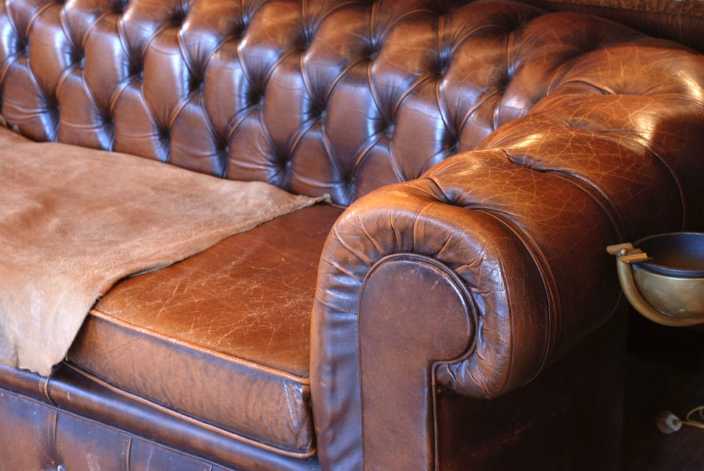 Close up of a brown leather couch