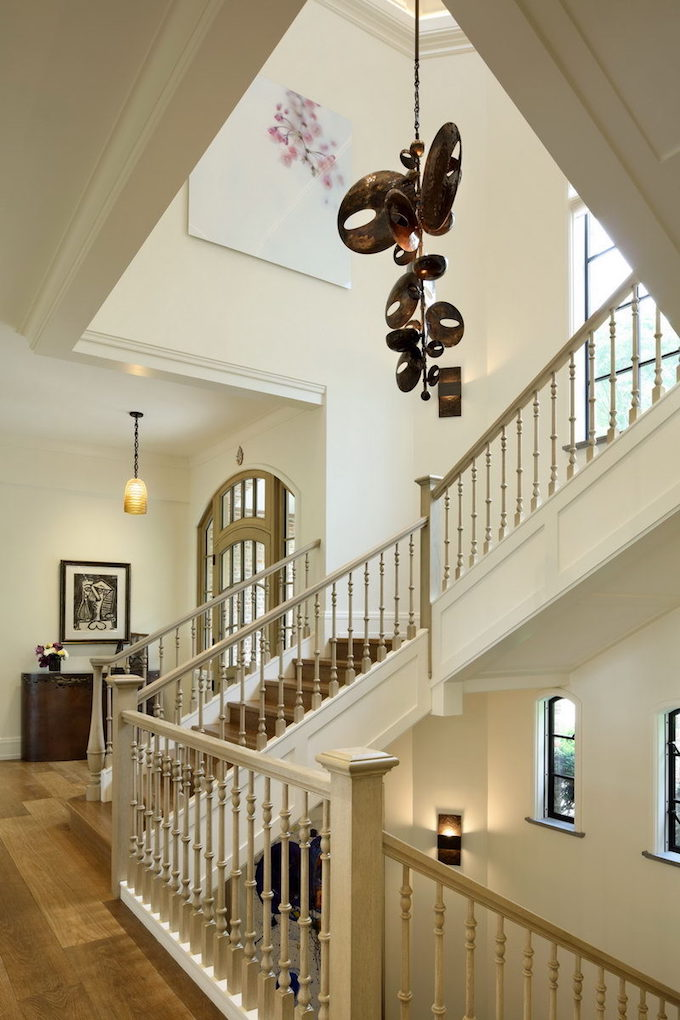 Staircase from the main landing inside Gisele Bündchen and Tom Brady's Boston mansion