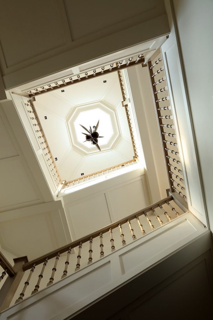 View from below of the staircase inside Gisele Bündchen and Tom Brady's Boston mansion
