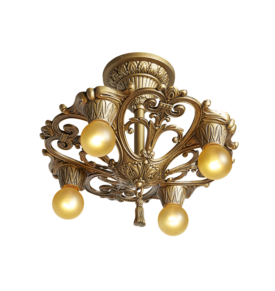 Example of antique statement lighting: a golden chandelier with four exposed light bulbs