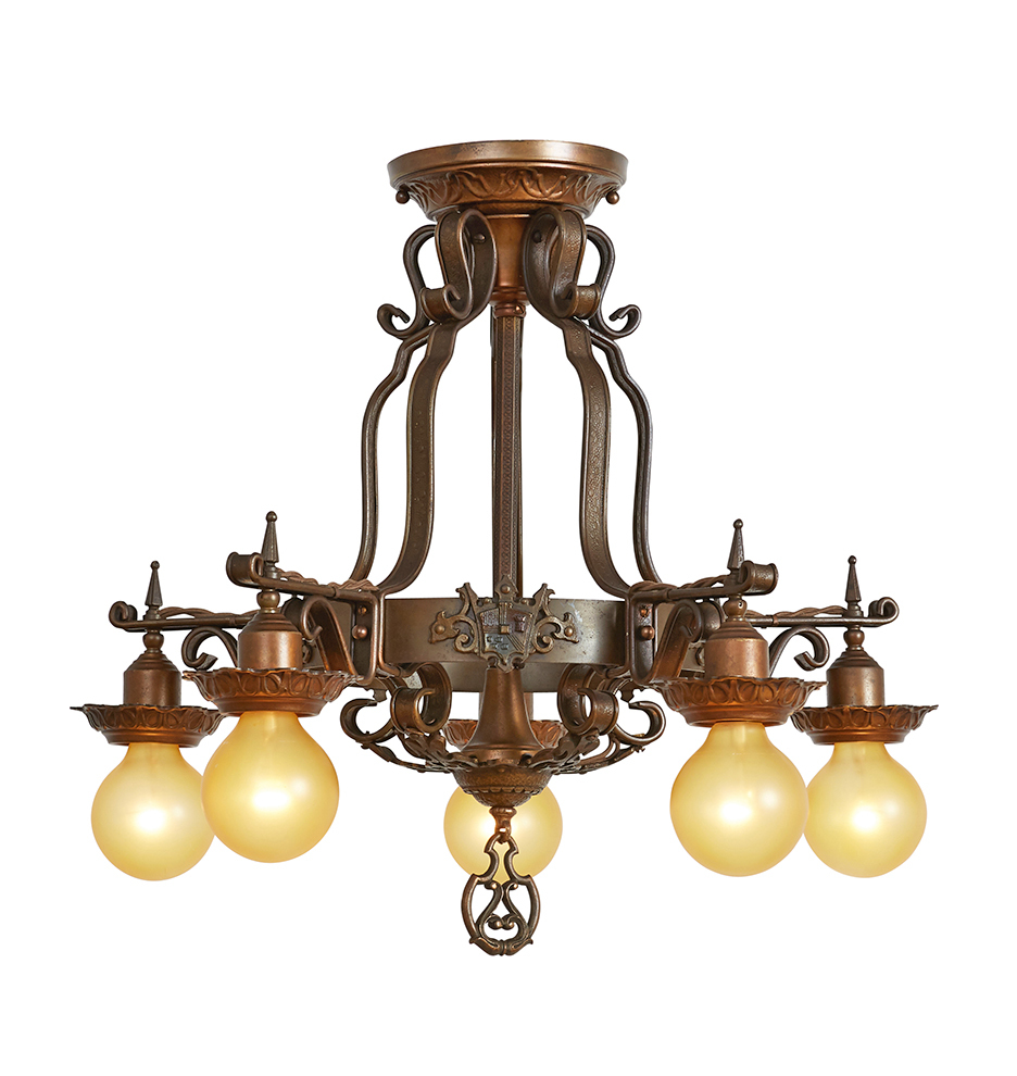Example of antique statement lighting: a brass chandelier with five exposed light bulbs