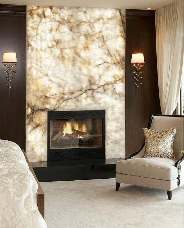 Backlit white onyx fireplace surround
