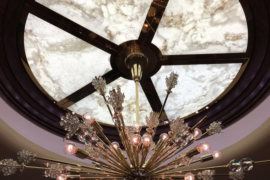 Illuminated white onyx ceiling panels with chandelier