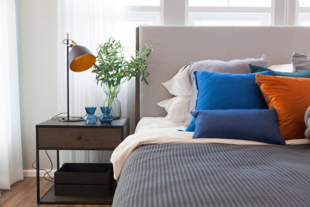 Classic Blue throw pillows accented with orange pillows