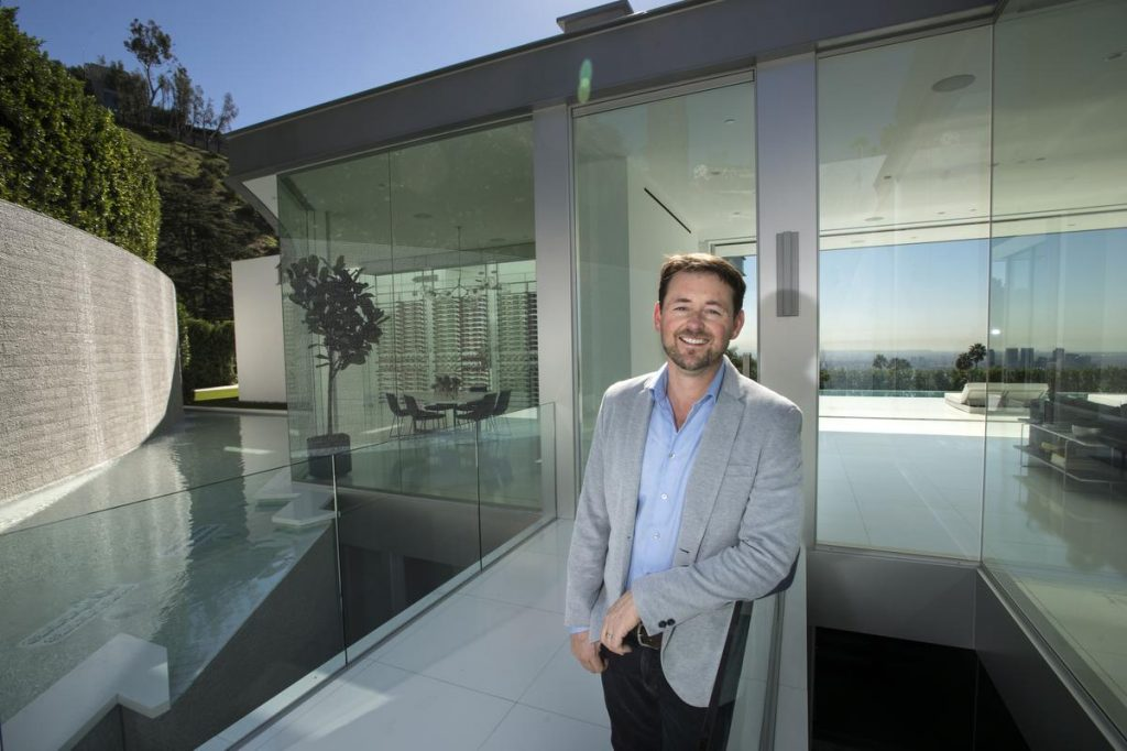 Paul McClean standing in front of a house he designed at Doheny Estates in Los Angeles