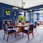 Navy blue Parsons chairs in a navy blue dining room