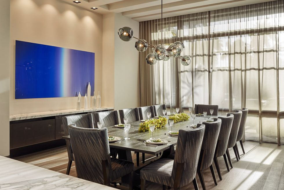 Gray Parsons chairs in a modern dining room
