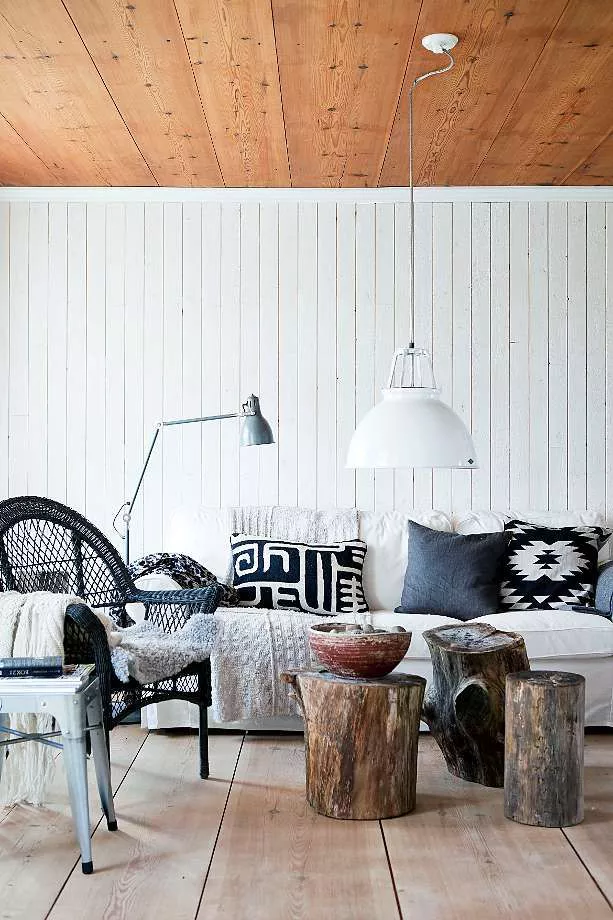 Living room with white wood paneling on the walls and natural wood paneling on the ceiling