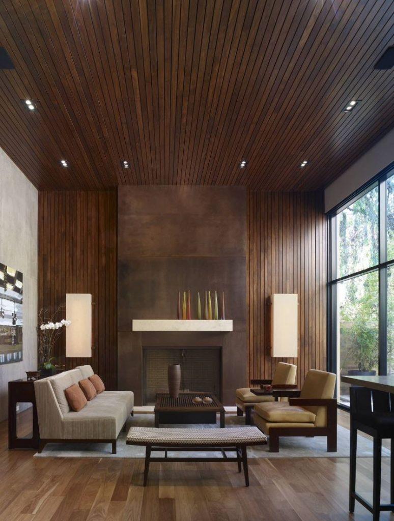 Vertical, dark wood paneling in a living room