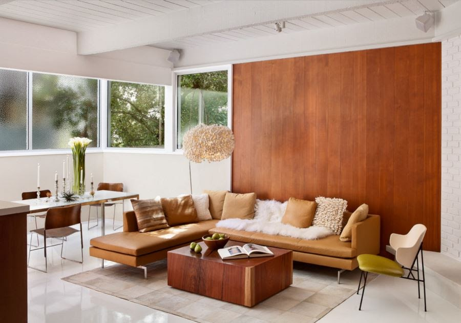 Warm wood paneling as an accent wall in a white room