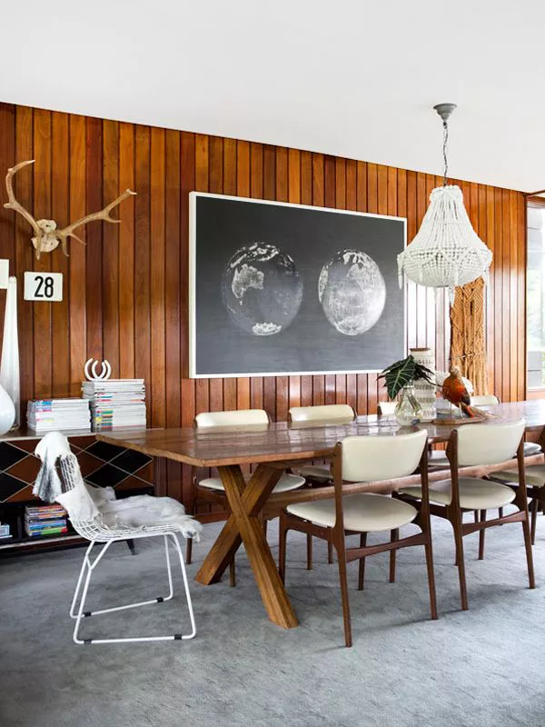 Vertical wood paneling in a dining room