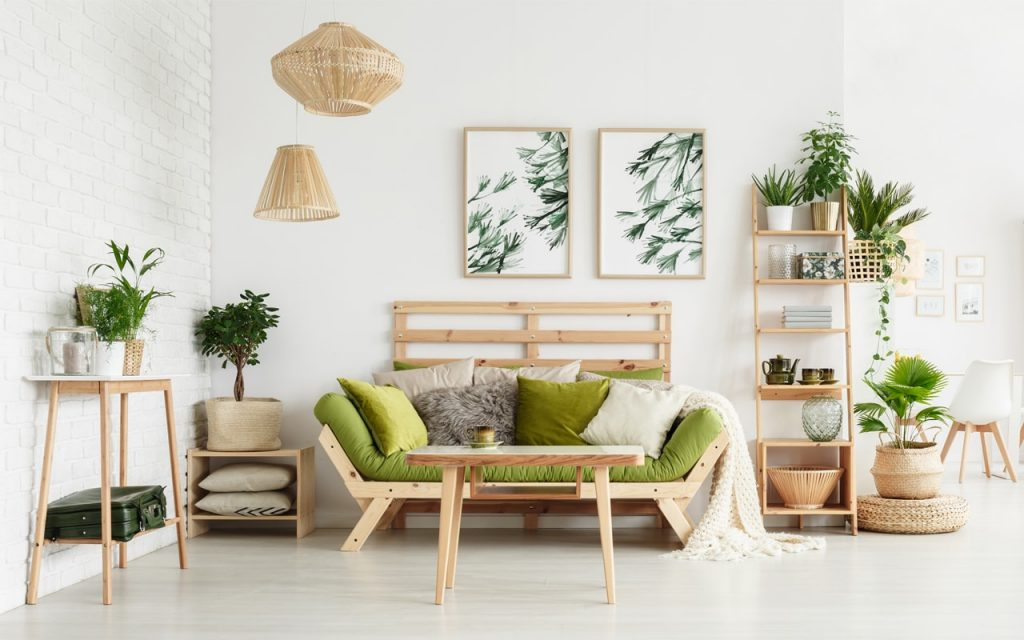 Living room sporting biophilic design elements such as unstained wooden furniture and botanical art