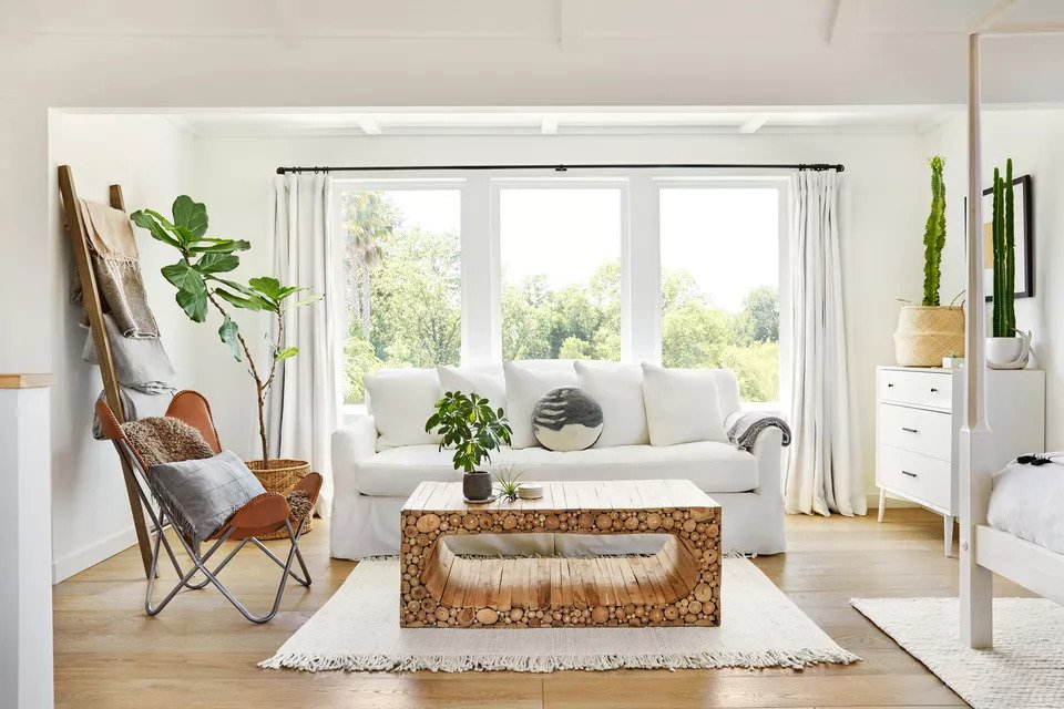 Example of biophilic design, a living room with wooden coffee table and houseplants