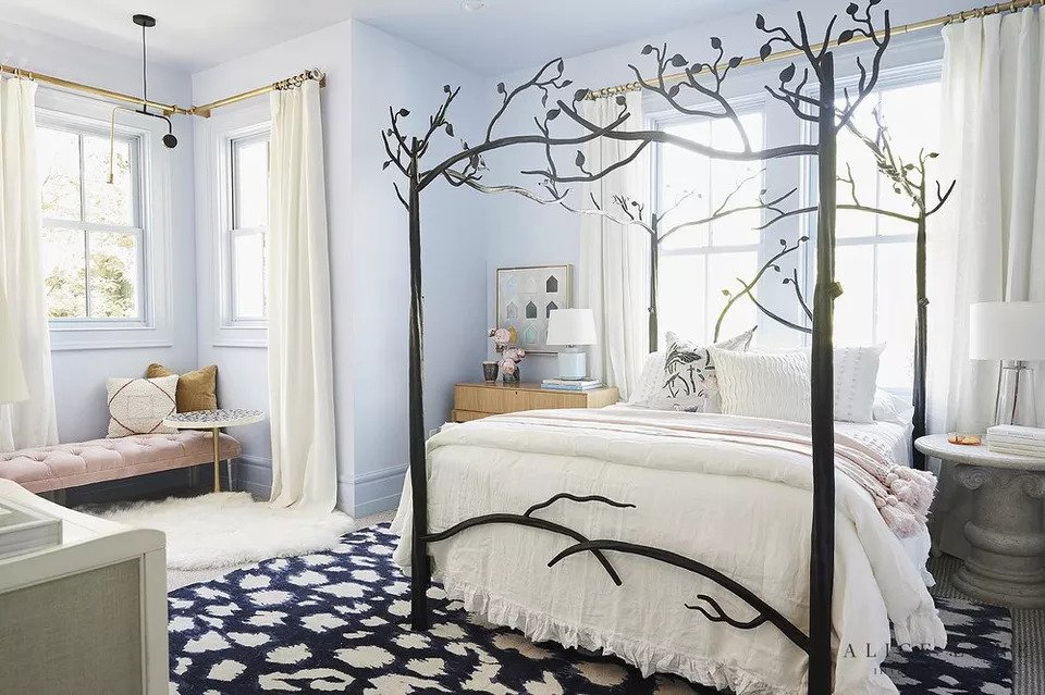 Canopy bed with posts that resemble tree branches