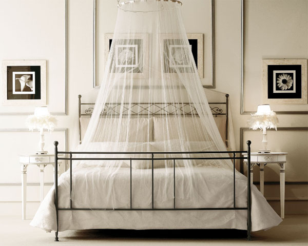 Bed with sheer netting hanging over top