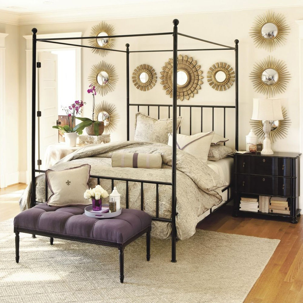 Modern canopy bed with minimalistic iron frame
