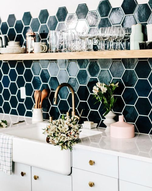 Backsplash with black hexagon tiles in a white kitchen