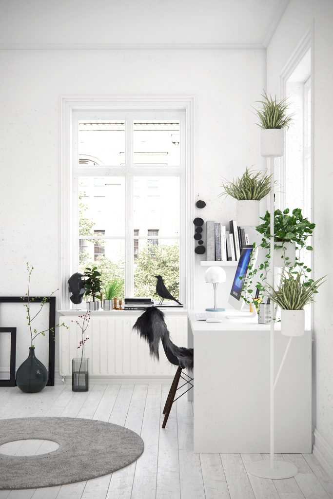 Home office with white color palette, black accents, large window, and plants.