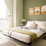 Neutral colored bedroom with green accent wall