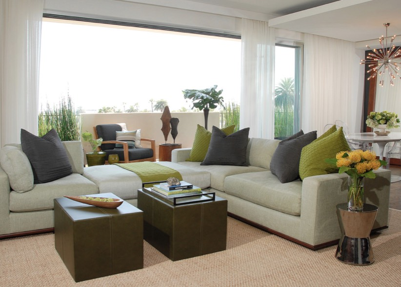 Living room with sectional couch and throw pillows in two shades of green.