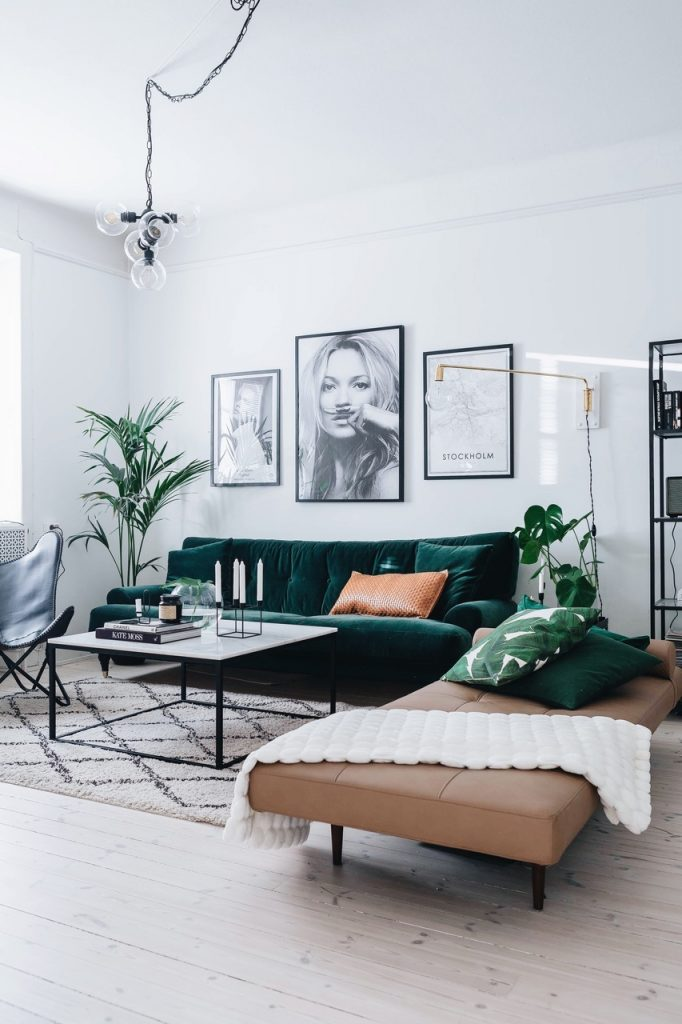 Living room with emerald green velvet couch.