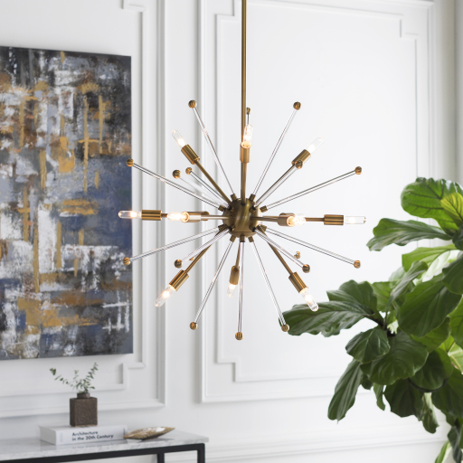 Close up of a Sputnik style ceiling light nearby a painting and plant.