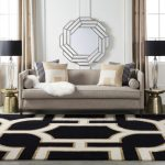 Living room with decorative mirror, sofa, and rug.