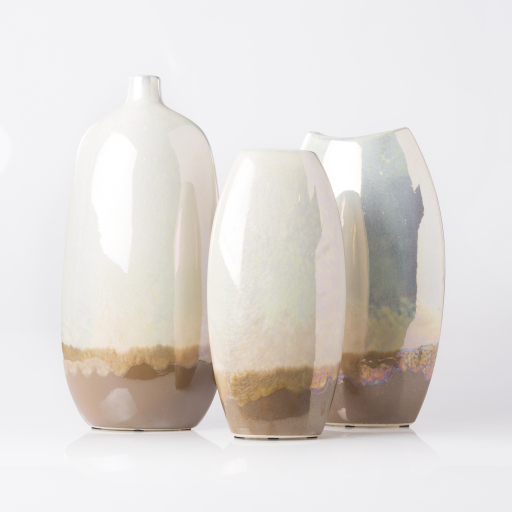 Three decorative vases varying in size.