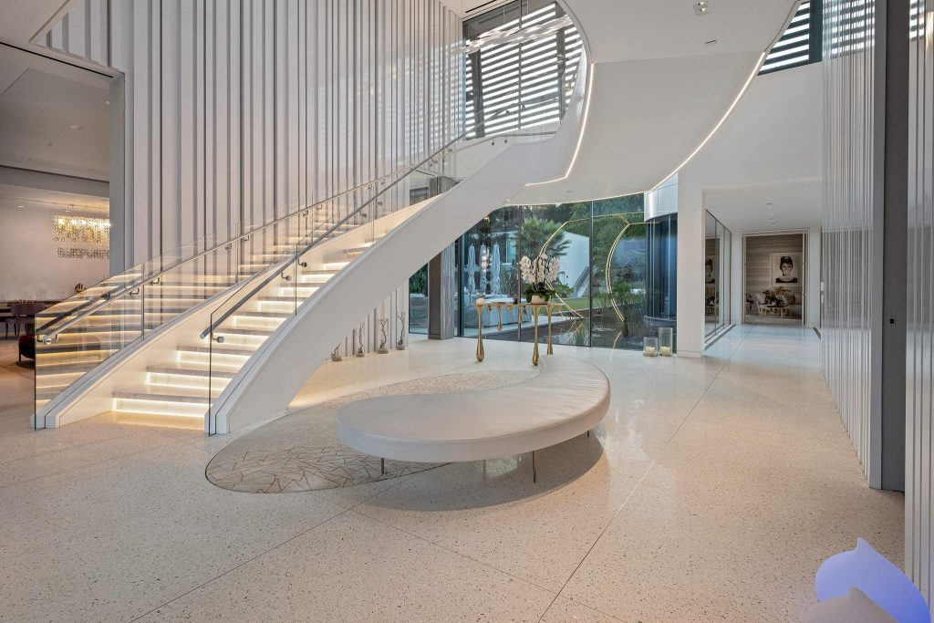 An elegant foyer with white floating staircase.