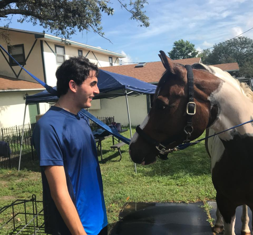 Young man with autism spectrum disorder at Spirit Horse at Windermere Equestrian Center