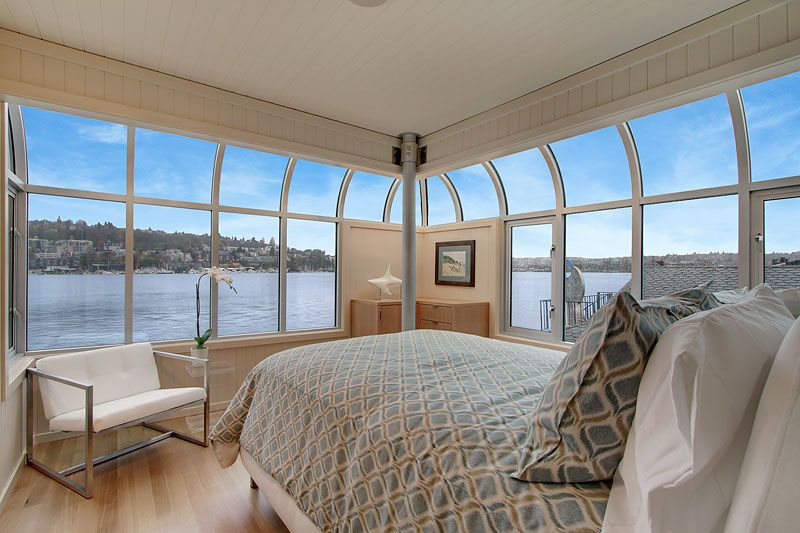 """The bedroom in the """"Sleepless in Seattle"""" designer houseboat with 360 degrees of ocean views."""