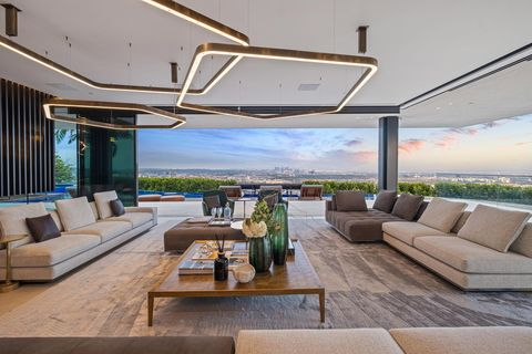 Living area with beautiful city views and unique light fixtures.