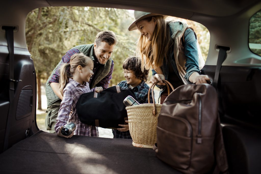 Close up of a family packing their car for a road trip.