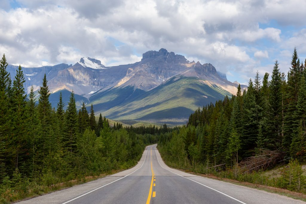 Picture of a road with mountains in the background.