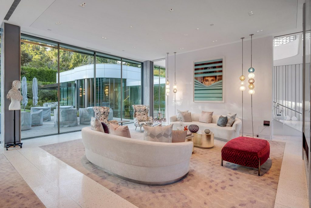 Living room with sofas and floor to ceiling windows.