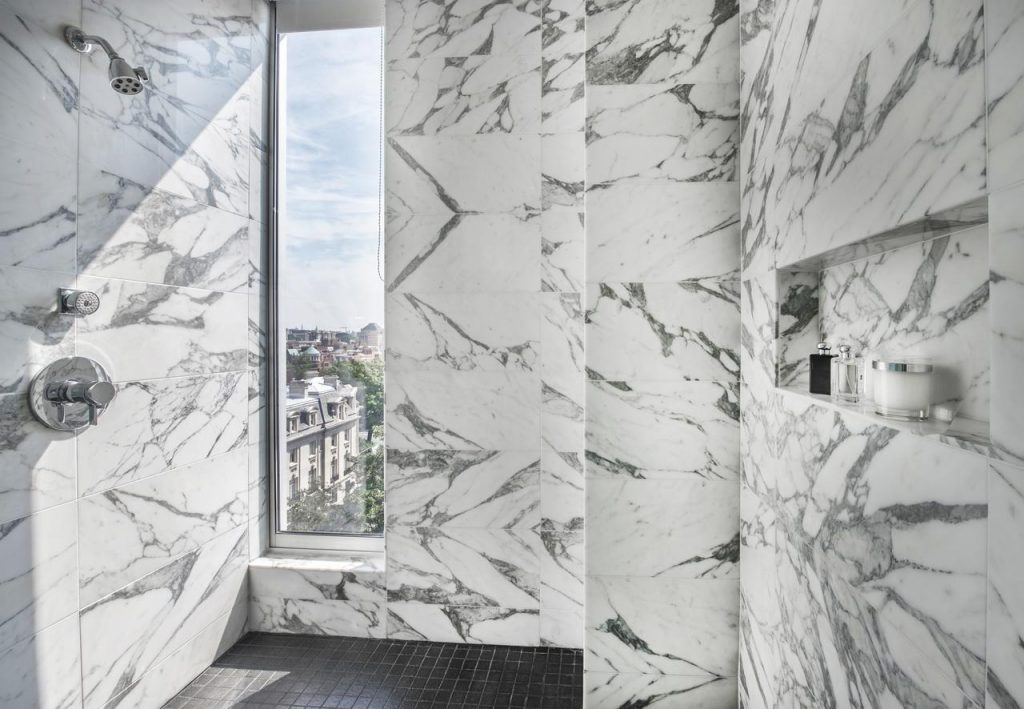 Large beautiful marble shower.