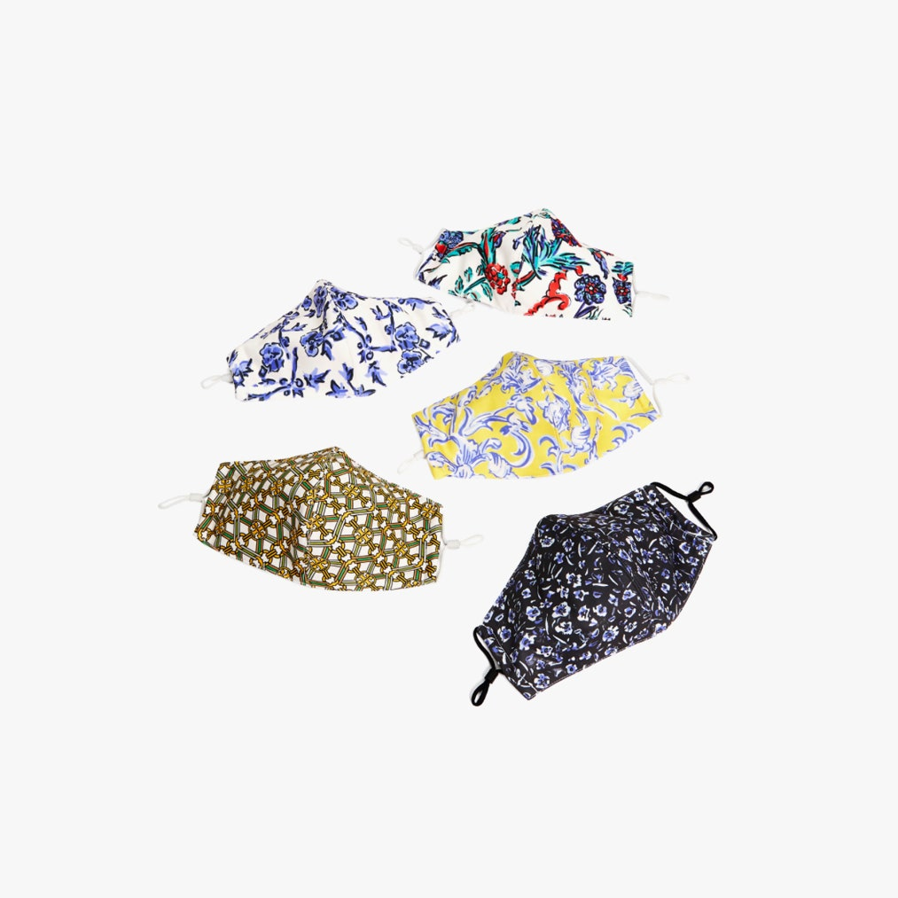 Five face masks with different prints.