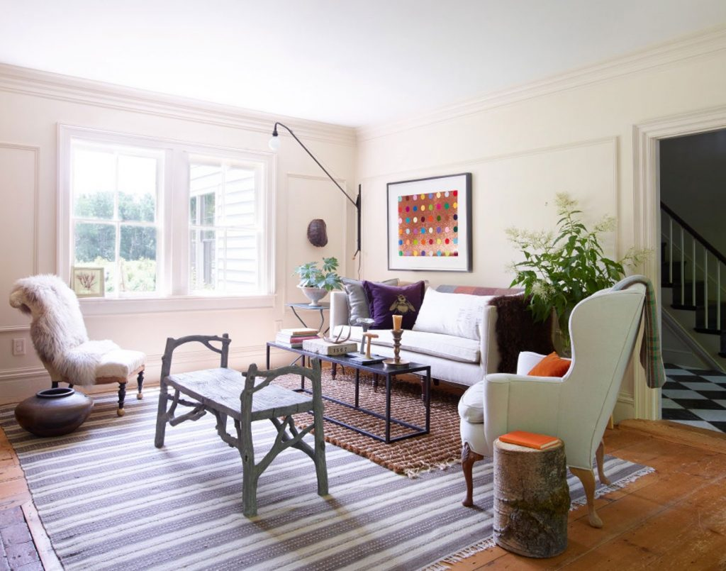 Living room white rugs and warm white walls.