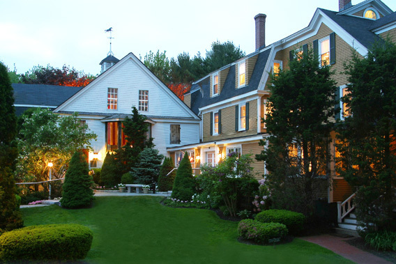 Beautiful exterior of the White Barn Inn with a lush green lawn.