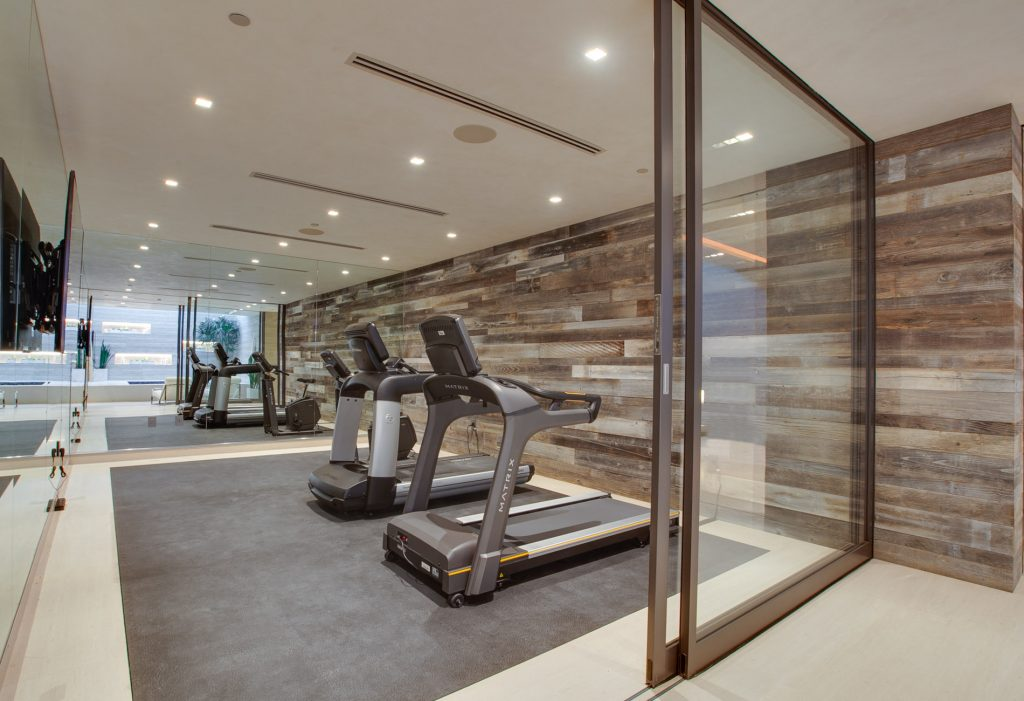 An exercise room with treadmills.